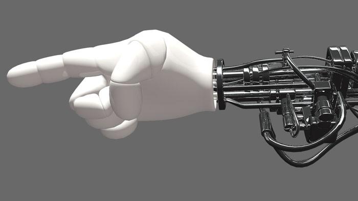 A robot hand - a human hand